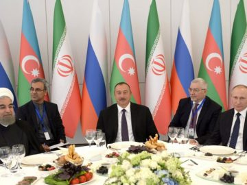 Image: Hassan Rouhani, Ilham Aliyev, and Vladimir Putin in Baku, 2016. Kremlin photo.