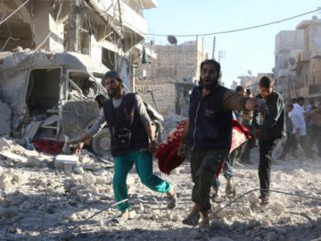 Syrian volunteers in Aleppo. (Thaer Mohammed/AFP/Getty Images)